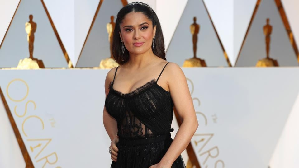 Salma Hayek poses on the red carpet. (REUTERS)