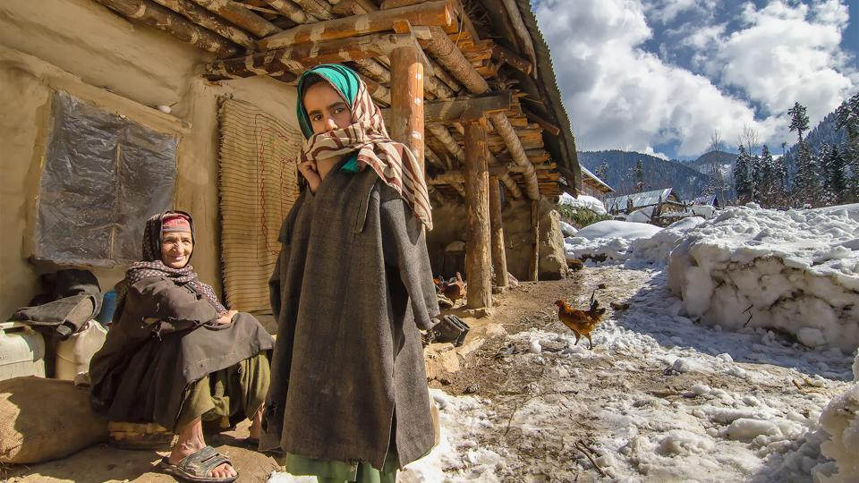 Villagers basking in the sun outside their house at the picturesque village of Daksum in South Kashmir. (Prasun Mitra)