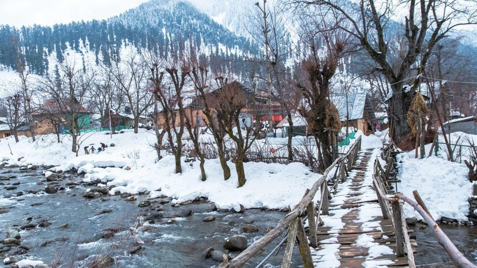 A footbridge over a stream in Pahalgam during the winter season. (Nilakkhya Dutta)