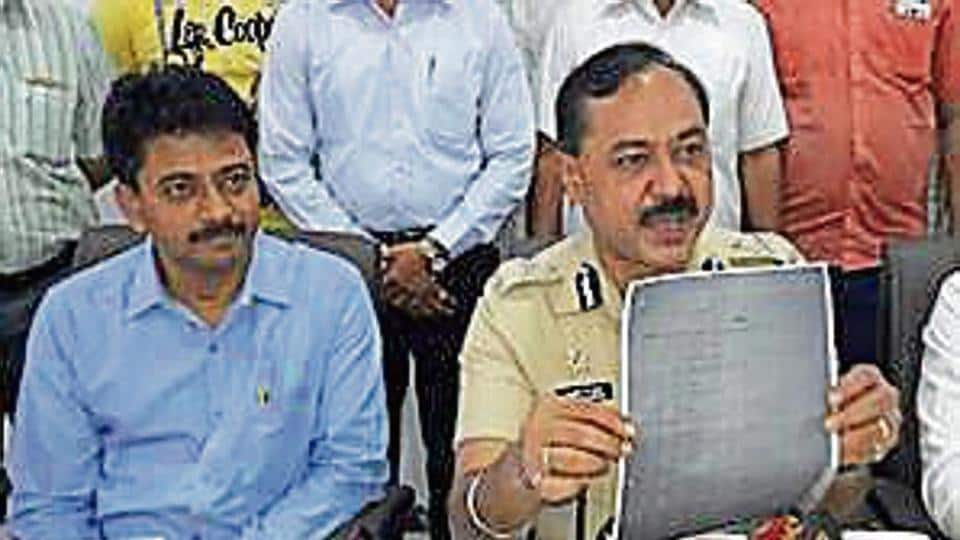Officials with a copy of the leaked exam paper.