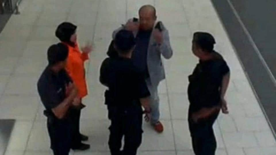A grab from a CCTV footage appears to show a man believed to be Kim Jong Nam talking to security personnel after being accosted by a woman in a white shirt, at Kuala Lumpur International Airport in Malaysia.