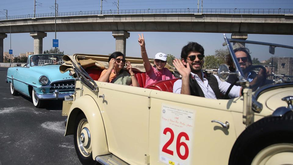 Participants flash victory sign during the 19th Vintage & Classic Car Rally, that was flagged off from Jai Mahal Palace.