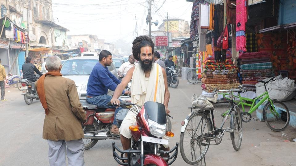 A sain riding a motorcycle in Ayodhya.