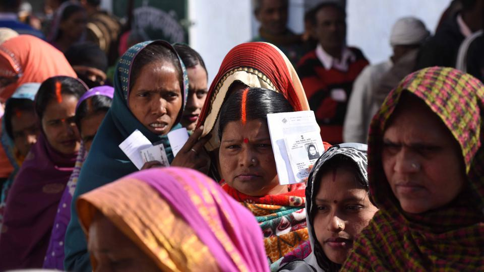 Voters line up to cast their votes at a polling station at Ayodhya in the northern Indian state of Uttar Pradesh, India, on Monday.