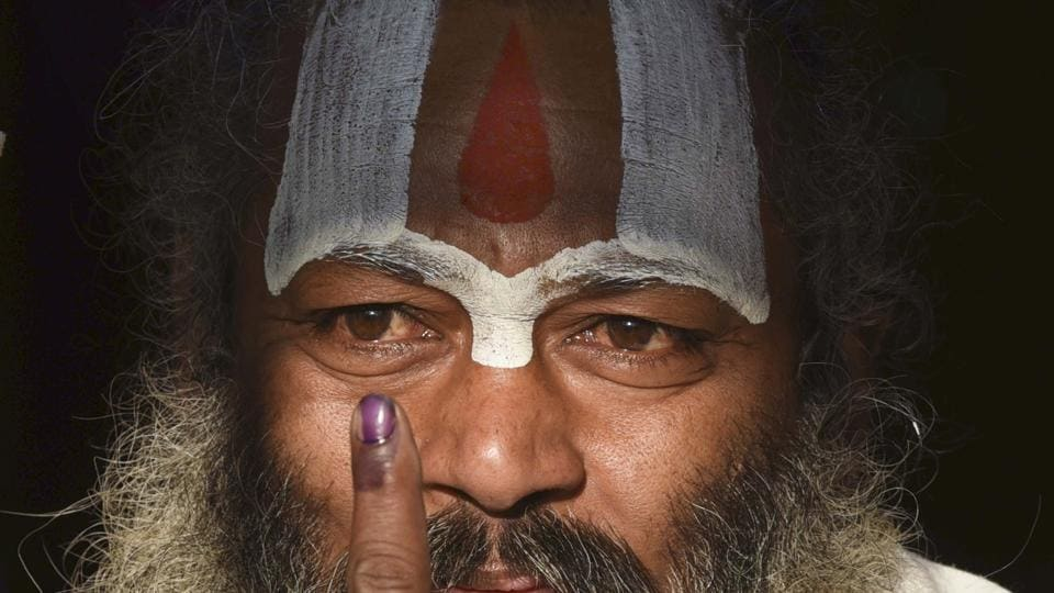 A Sadhu shows his inked finger after casting his vote at a polling booth during elections in Ayodhya on 27th February 2017. The 5th phase of polling for 51 assembly seats is spread across 11 districts in Uttar Pradesh. (Arun Sharma/HT PHOTO)