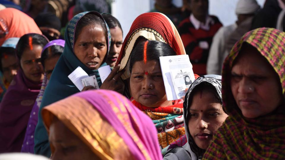Women queue up to cast their votes at a polling station at Ayodhya. The districts going to polls in this phase are Balrampur, Gonda, Faizabad, Ambedkar Nagar, Bahraich, Shravasti, Basti, Siddharth Nagar, Sant Kabir Nagar, Amethi and Sultanpur. (Arun Sharma/HT PHOTO)