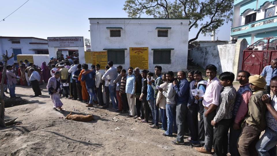 Voters await their turn as they line up to cast their votes at a polling station. (Arun Sharma/HT PHOTO)