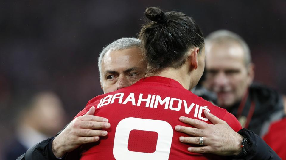 Manchester United manager Jose Mourinho hugs Zlatan Ibrahimovic after they won the League Cup final against Southampton FC at the Wembley in London on Sunday.