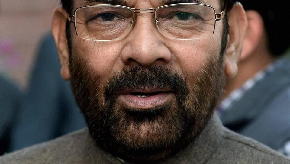 Mukhtar Abbas Naqvi talks to media outside Parliament in New Delhi.