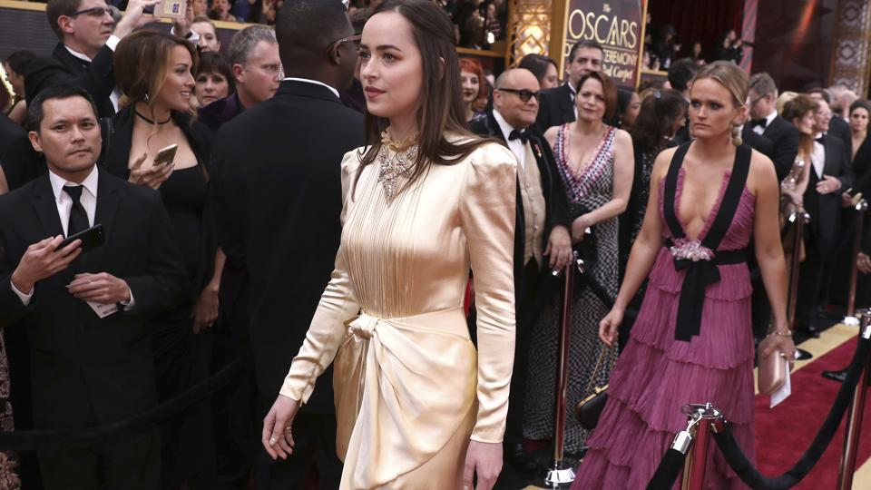Dakota Johnson arrives at the Oscars ceremony in Los Angeles on Monday. (AP)