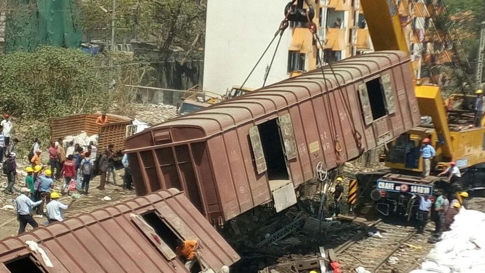 Railway authorities are clearing the tracks to resume services on the suburban line. (Vijayanand Gupta/ HT Photo)