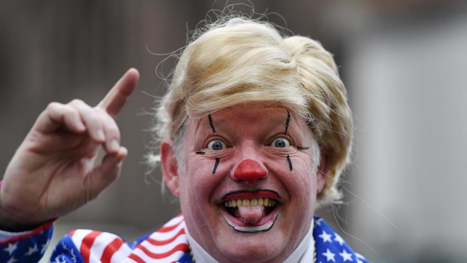 A reveller dressed as US president Donald Trump is pictured at the traditional carnival parade in Duesseldorf, Germany.