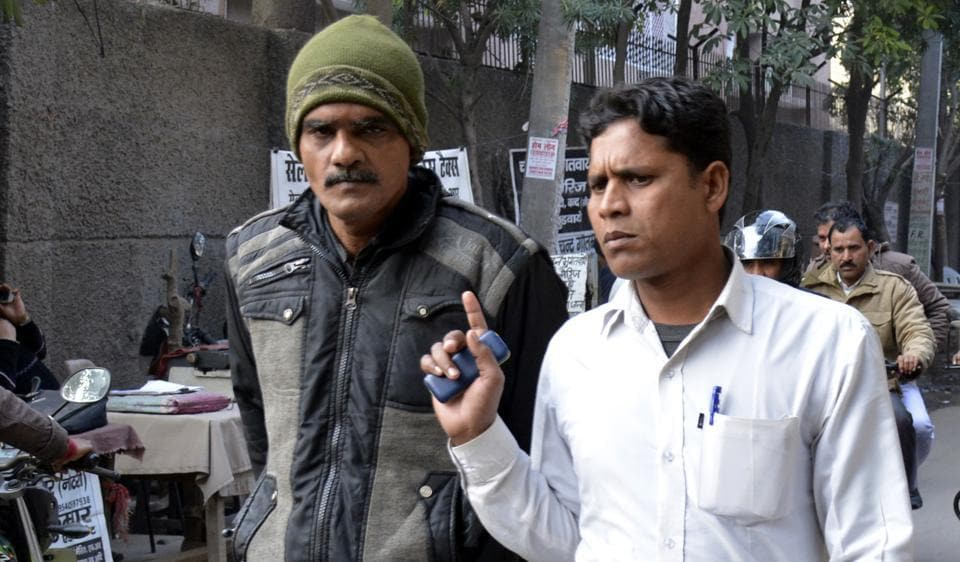 Syed Imtiyaz Qadri, who claimed that he was Ishaq Khan, in police custody. The owner of Audi that crashed in an auto in Ghaziabad, Dr Manish Rawat, had claimed that Khan was driving the car at the time of accident.
