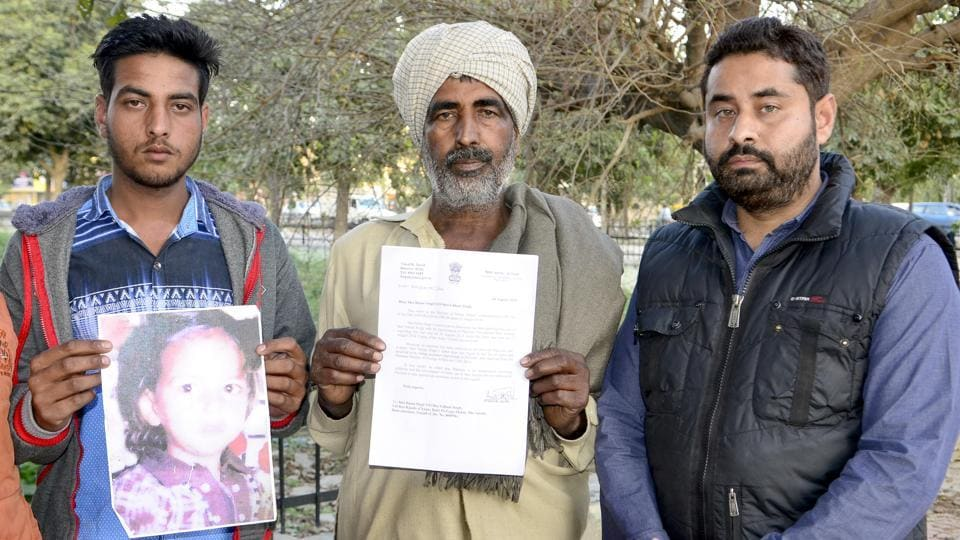 Student federation president Keshav Kohli (Right) along with the father(Centre)and brother (Left) of Nanak Singh who is in a Pakistan jail, in Amritsar on Sunday.