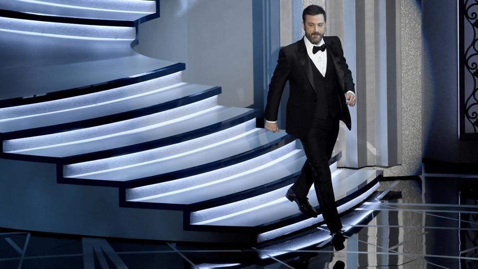 Host Jimmy Kimmel walks on stage at the Oscars on Monday.