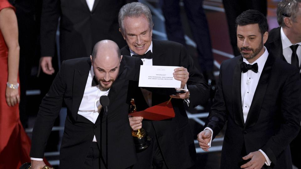 Jordan Horowitz, producer of La La Land, shows the envelope revealing Moonlight as the true winner of best picture at the Oscars.