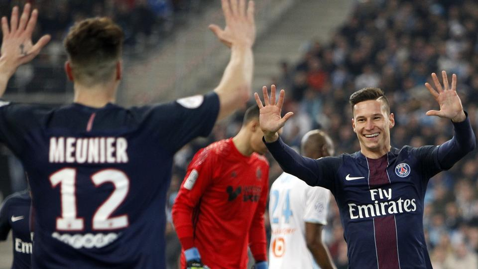 Paris Saint Germain's Julian Draxler (right) celebrates with Thomas Meunier after scoring  during their League One match against Marseille on Sunday.