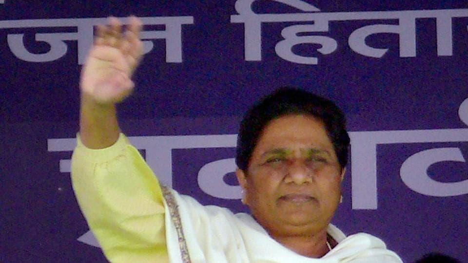 BSP supremo Mayawati waves at crowd at an election rally in Azamgarh on Monday.