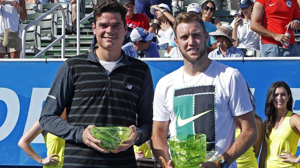 Milos Raonic,left, and Jack Sock, right, pose with their trophies after the 2017 Delray Beach Open.