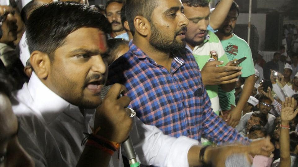 Hardik Patel addresses people from the Patidar community at a public meeting in Ahmedabad.