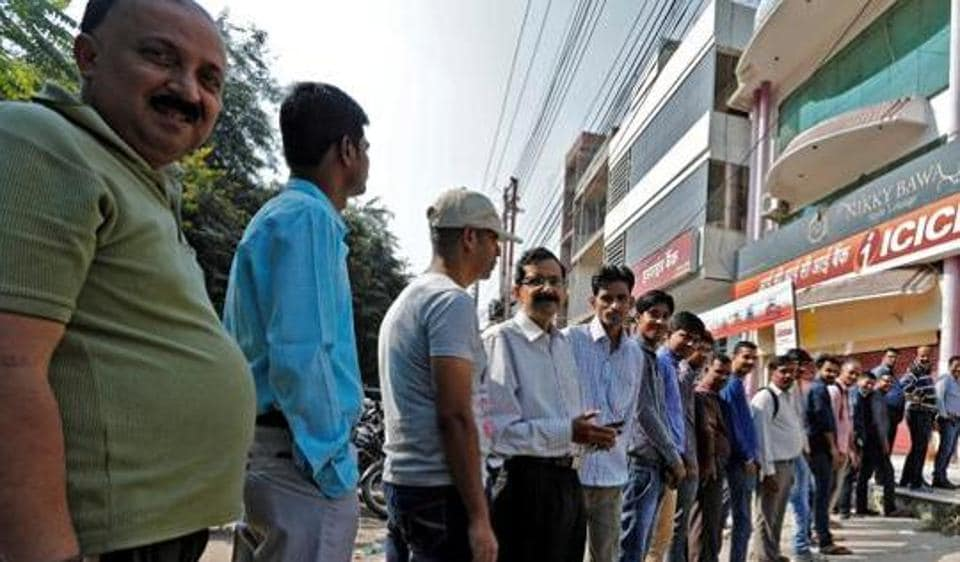 People queue to withdraw cash at the ICICI bank ATM in Lucknow post demonetisation.