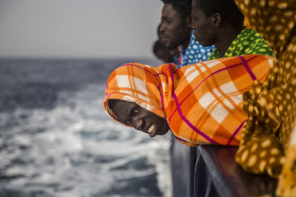 African refugees look at the sea aboard the Golfo Azurro, a rescue ship of the Spanish Proactiva Open Arms NGO, after being rescued from a boat out of control at 25 miles north of Sabratha, off the Libyan coast. (Santi Palacios / AP)