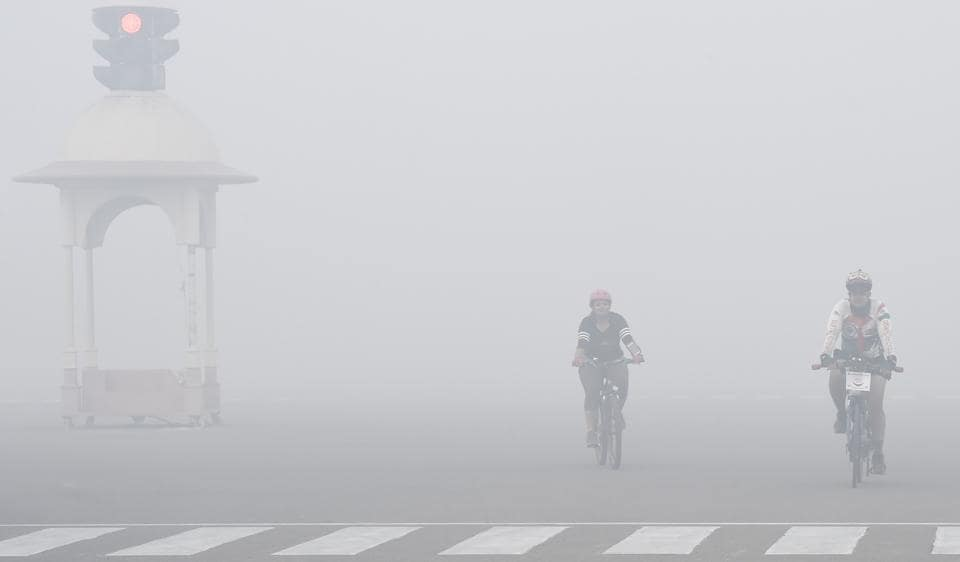 Cyclists during smog near Vijay chowk after Diwali in 2016.