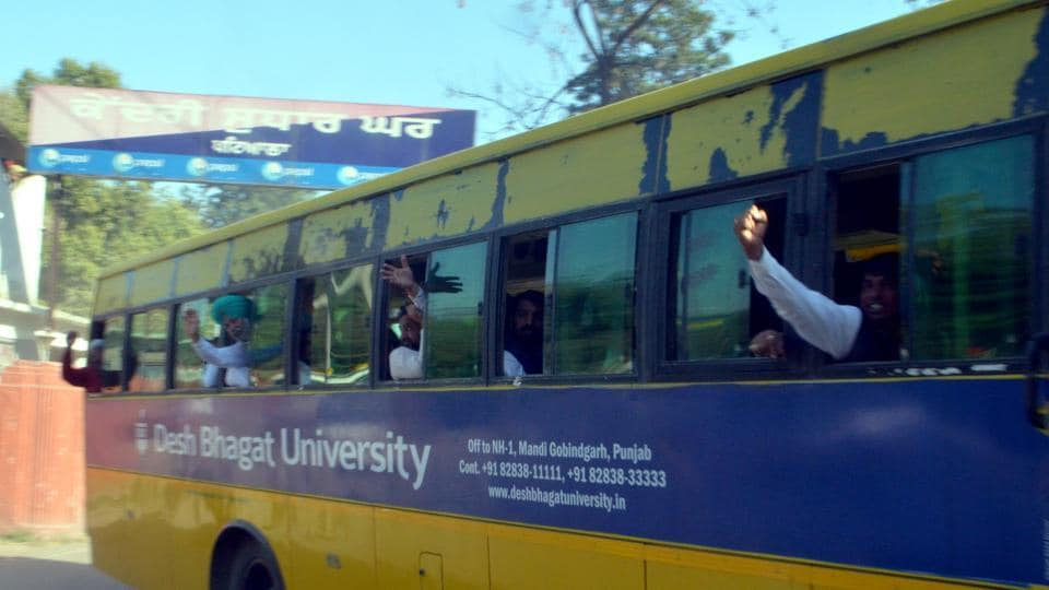 INLD workers being brought out from Patiala jail in a bus on Monday.