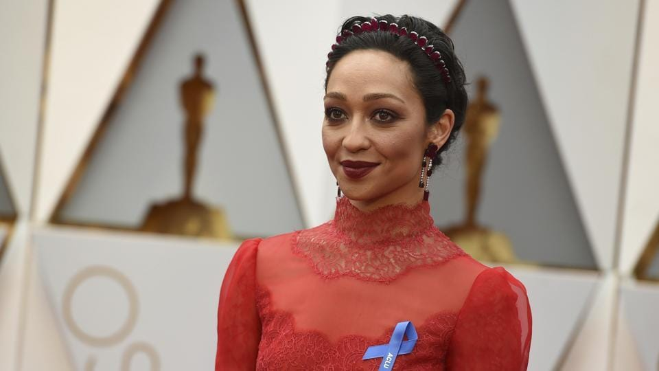 Ruth Negga wears an ACLU ribbon as she arrives at the Oscars at Los Angeles on Monday.