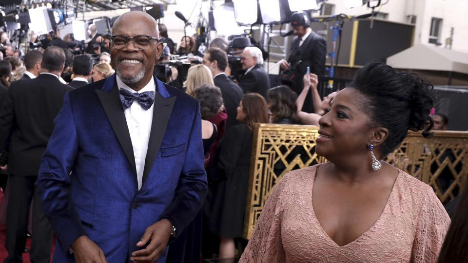 Samuel L. Jackson (left) and LaTanya Richardson arrive at the Oscars on Monday. (AP)