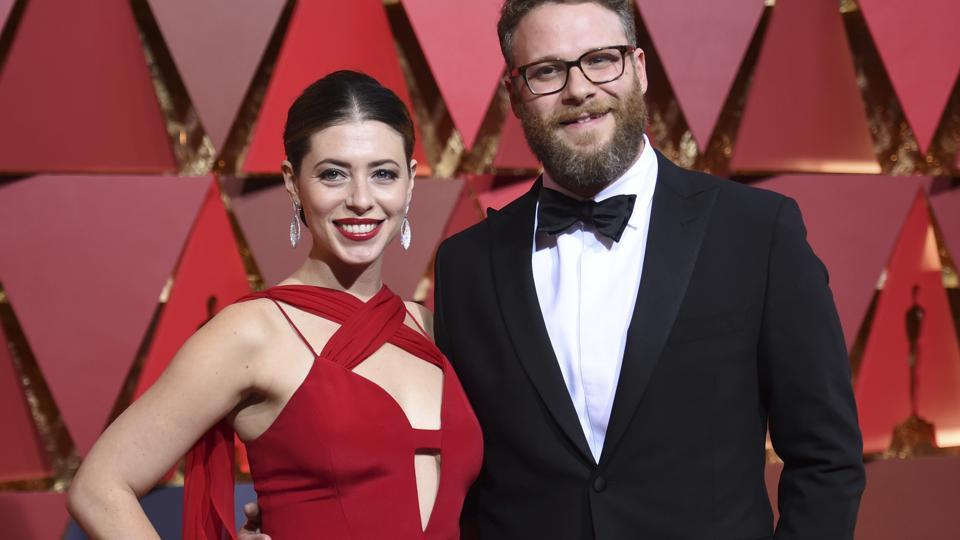 Seth Rogen (right) and Lauren Miller arrive at the Oscars on Monday. (AP)