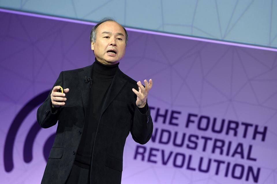 Founder & amp CEO of SoftBank Group, Masayoshi Son, speaks during a keynote speech at the Mobile World Congress in Barcelonaon February 27, 2017 in Barcelona. Phone makers will seek to seduce new buyers with artificial intelligence functions and other innovations at the world's biggest mobile fair starting today in Spain. / AFP PHOTO / LLUIS GENE
