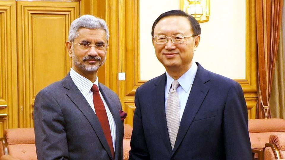 Foreign secretary S Jaishankar shakes hands with Chinese state councillor Yang Jiechi in Beijing.