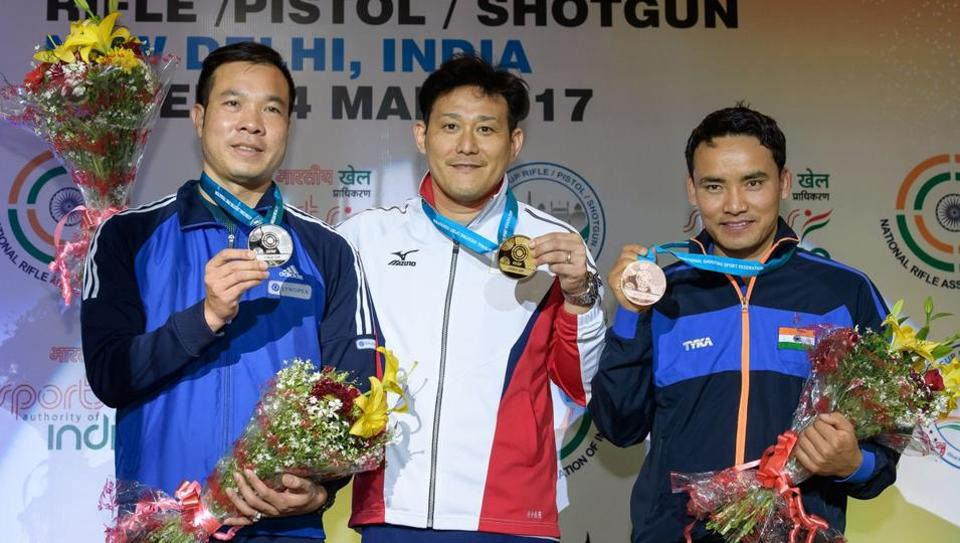 Jitu Rai (right) with 10m air pistol gold medallist Tomoyuki Matsuda (centre) and silver medallist Vinh Xuan Hoang at the ISSF World Cup.