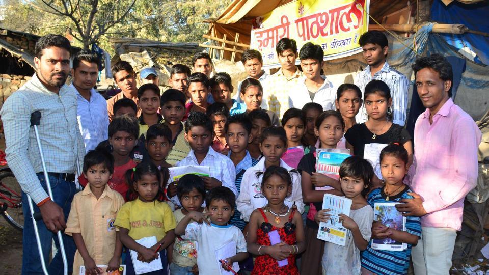 AU student Rajneesh Dubey (extreme left) along with slum kids here in Alopibagh on Monday.