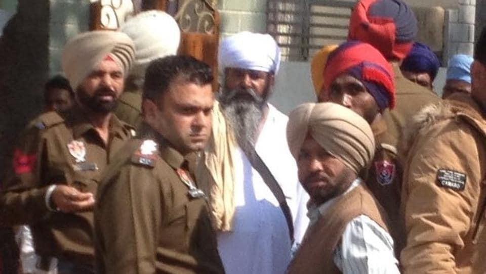 Ek Noor Khalsa Fauj leader Dilbagh Singh in police custody and police arresting Sikh radicals at Mallanwala in Ferozepur on Tuesday.