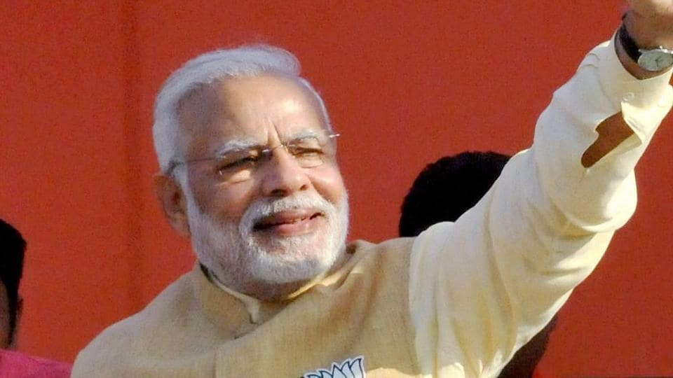 Prime Minister Narendra Modi waves at the crowd at an election rally in Haridwar.