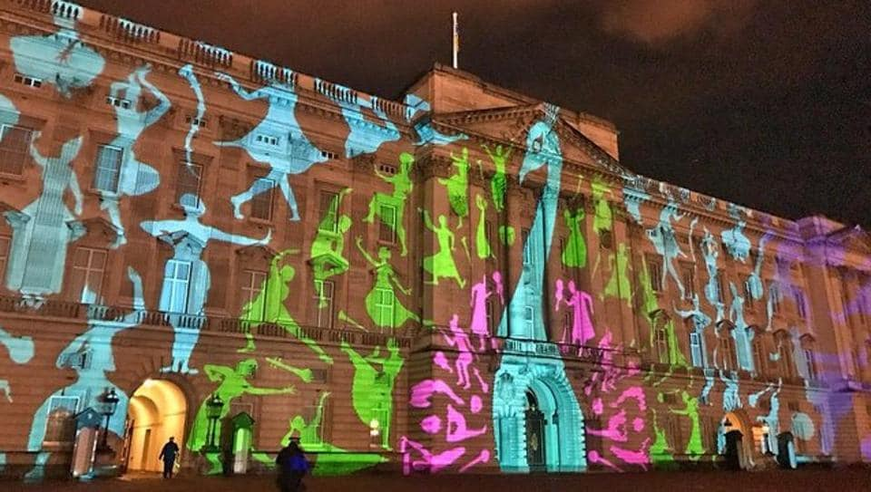 Projection on the front facade of Buckingham Palace depicting India's national bird, peacock.