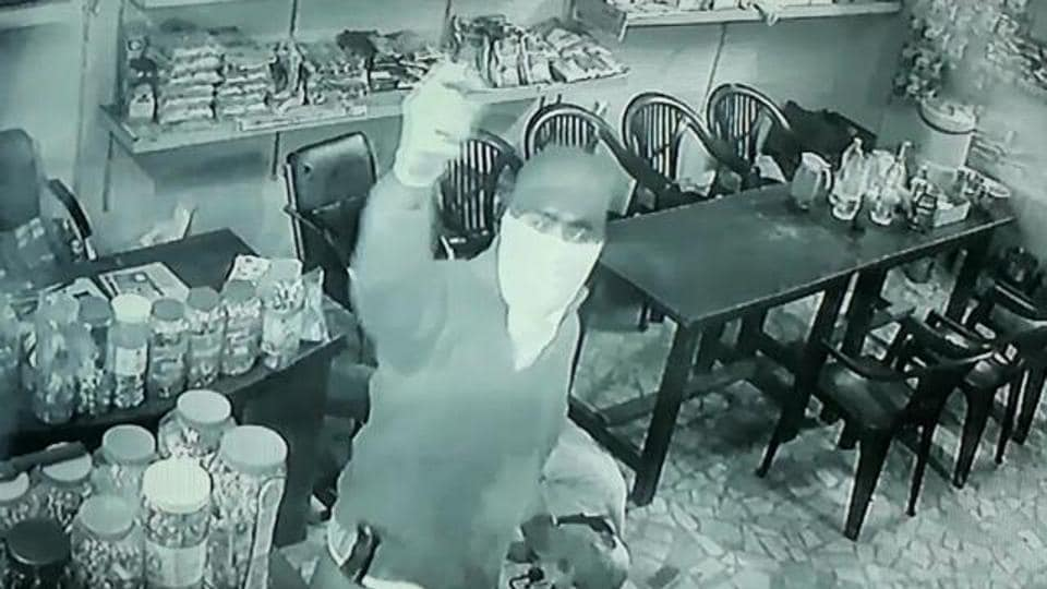 One of the gunmen inside the canteen.