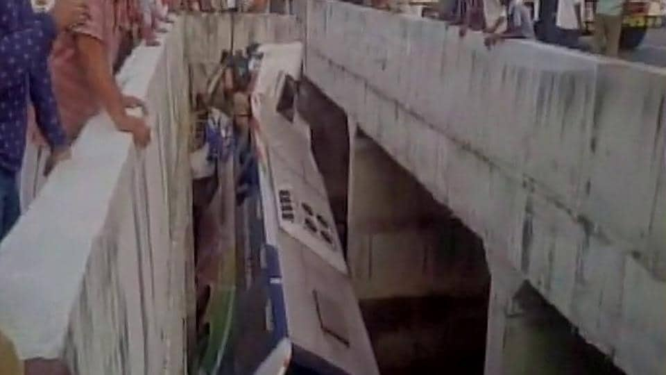 The bus rolled into a canal after crashing into a road divider in Andhra's Krishna district early Tuesday.