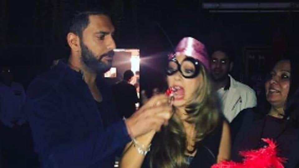 Yuvraj Singh feeds Hazel Keech a piece of her birthday cake during the party on Monday night. His friend and teammate Harbhajan Singh was also part of the fun.