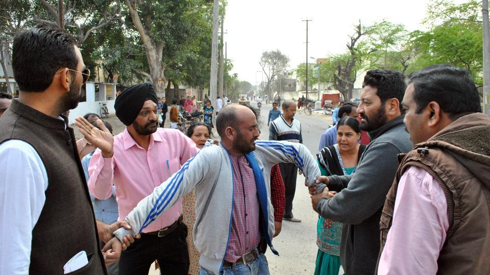 The snatcher being beaten by people in Bathinda on Tuesday morning.