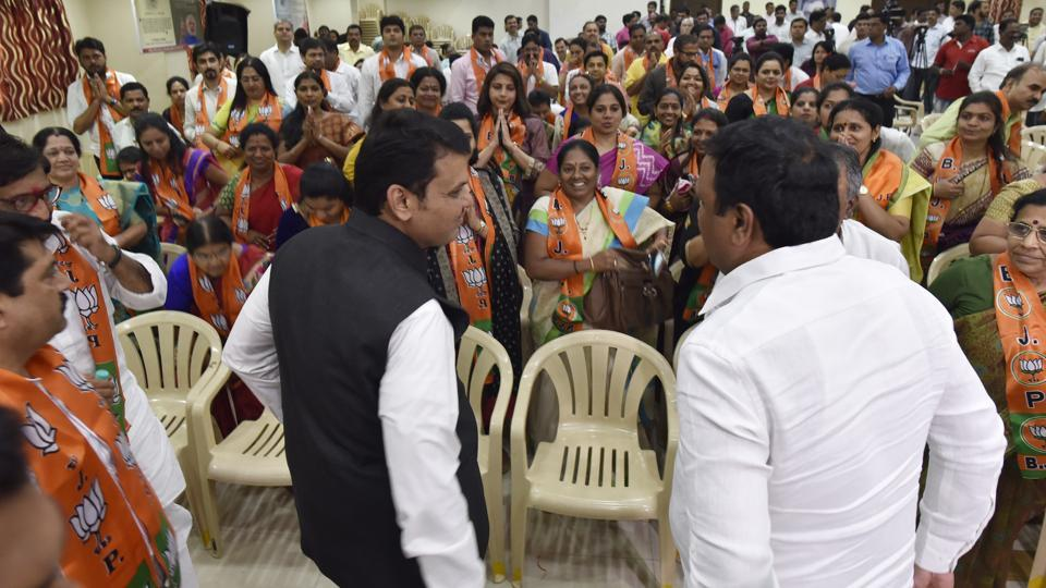 Maharashtra chief minister Devendra Fhadnavis and BJP's Mumbai unit chief Ashish Shelar with the newly elected councillors at BJP office in Mumbai on Monday.