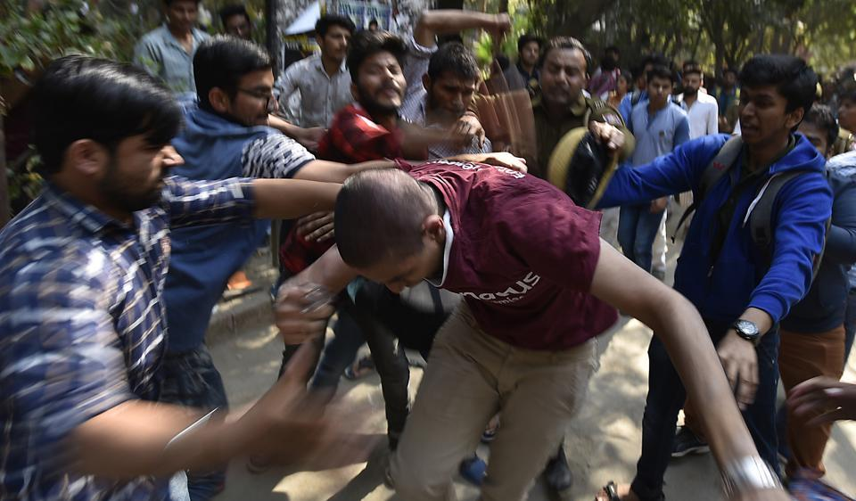 Activists of ABVP beating Ramjas students  after JNU student Umar Khalid was invited to the college for a literary festival.