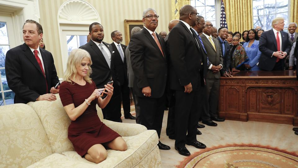 Kellyanne Conway sits on a couch as US President Donald Trump meets with leaders of Historically Black Colleges and Universities (HBCU) in the Oval Office of the White House in Washington.