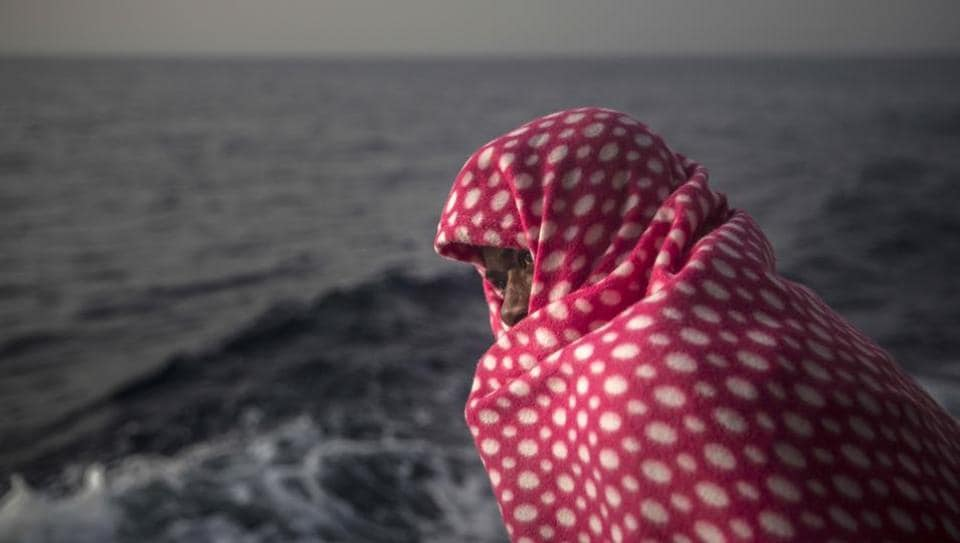 A migrant rests aboard Golfo Azurro, the Spanish NGO Proactiva Open Arms rescue ship, off the Libyan coast.