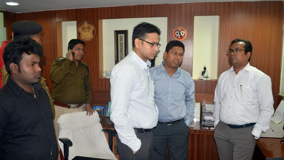 Police officials going through CCTV footage after robbery at Axis bank in Dhanbad February 27
