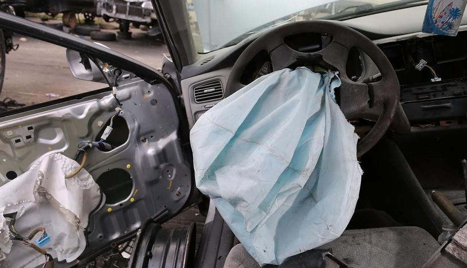 This file photo taken on May 21, 2015 shows a deployed air bag is seen in a 2001 Honda Accord at the LKQ Pick Your Part salvage yard in Medley, Florida.
