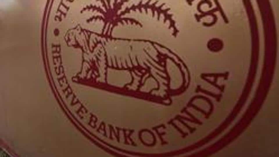 A logo of the Reserve Bank of India (RBI) in front of its building in Kolkata.