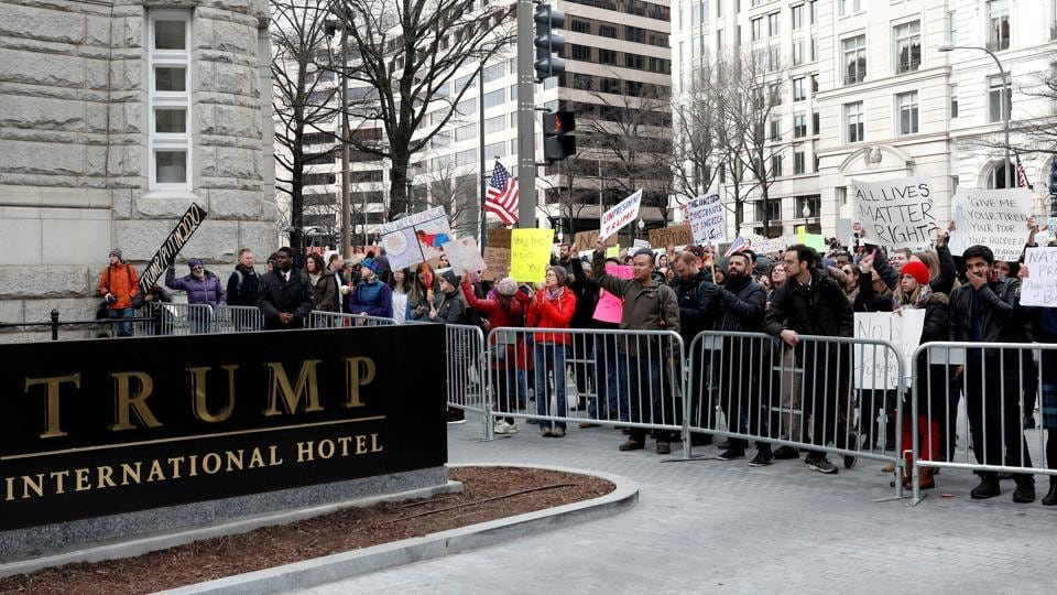 Activists gather outside the Trump International Hotel in Washington DCto protest against USPresident Donald Trump's executive actions on immigration.